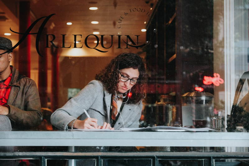Woman working at a cafe