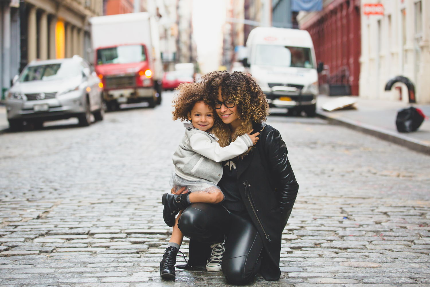 Woman with her daughter on a city street