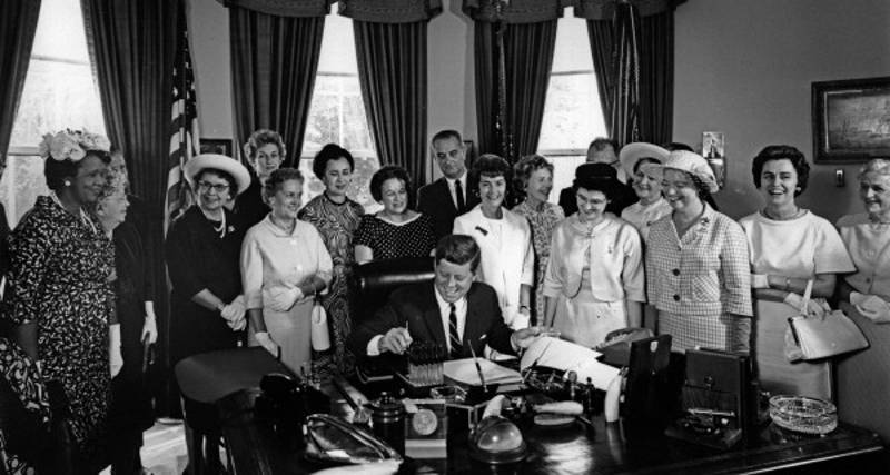 John F. Kennedy signing the Equal Pay Act into law