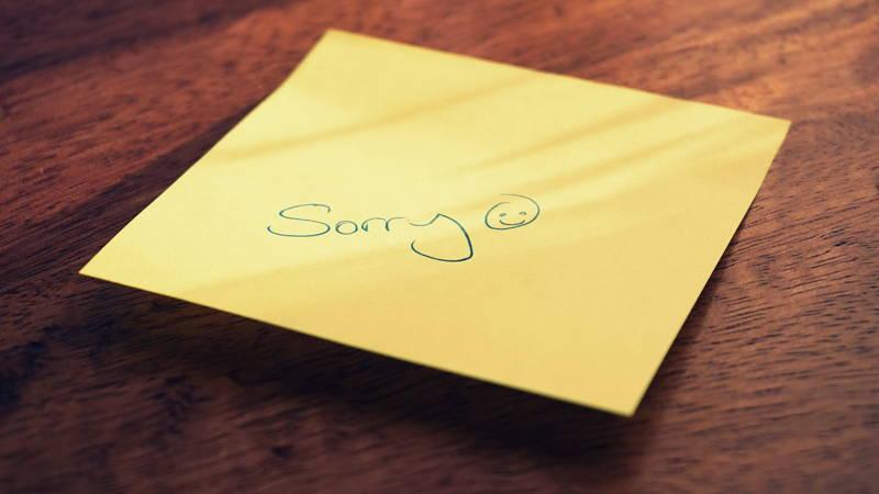 'Sorry' written on a sticky note