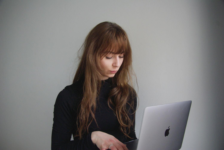 Woman writing a LinkedIn summary
