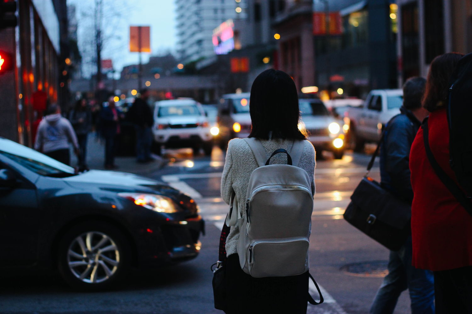 Woman carrying a work backpack