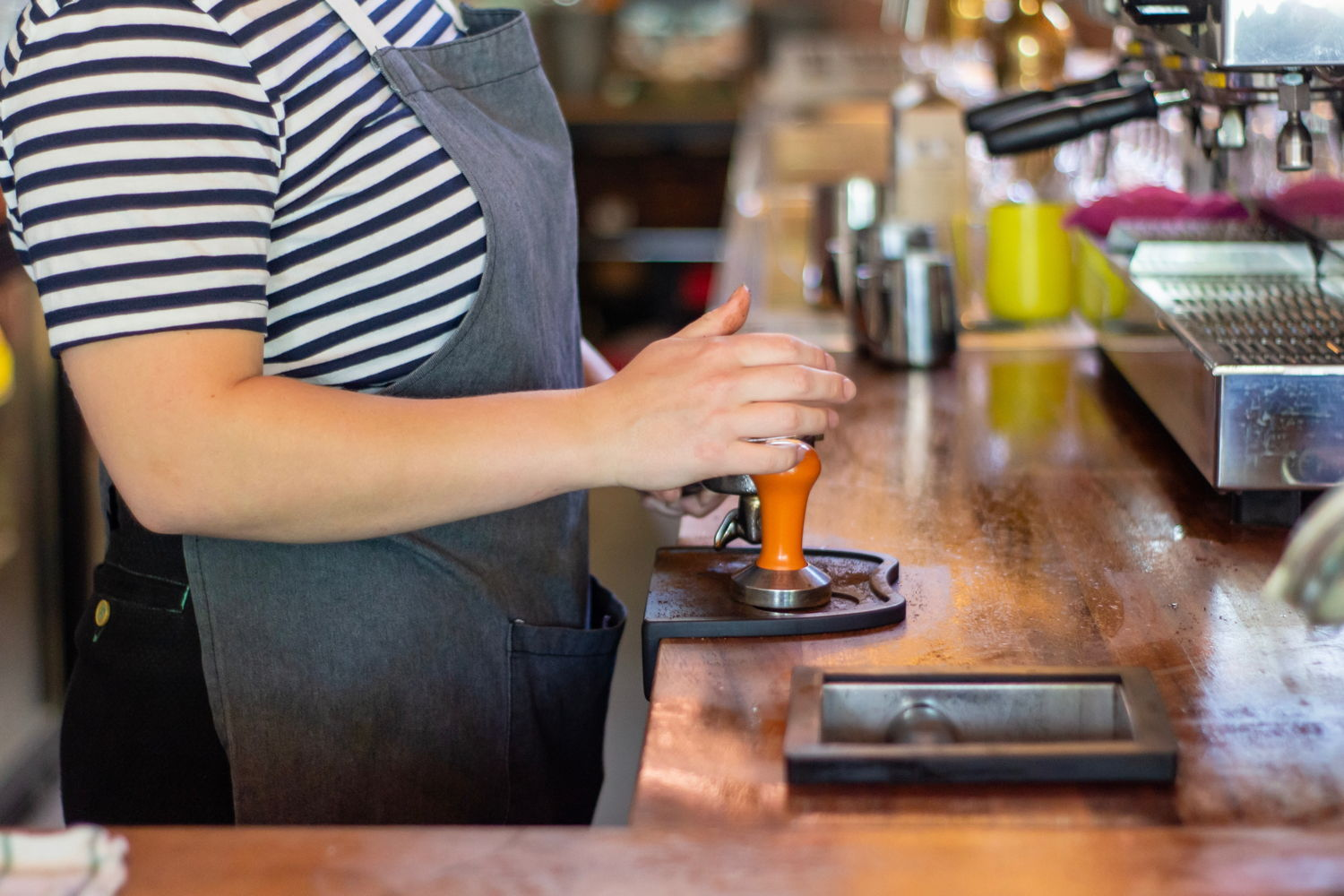 Woman working at a coffee shop