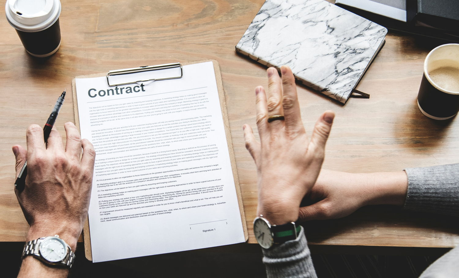 two people negotiating an employment contract