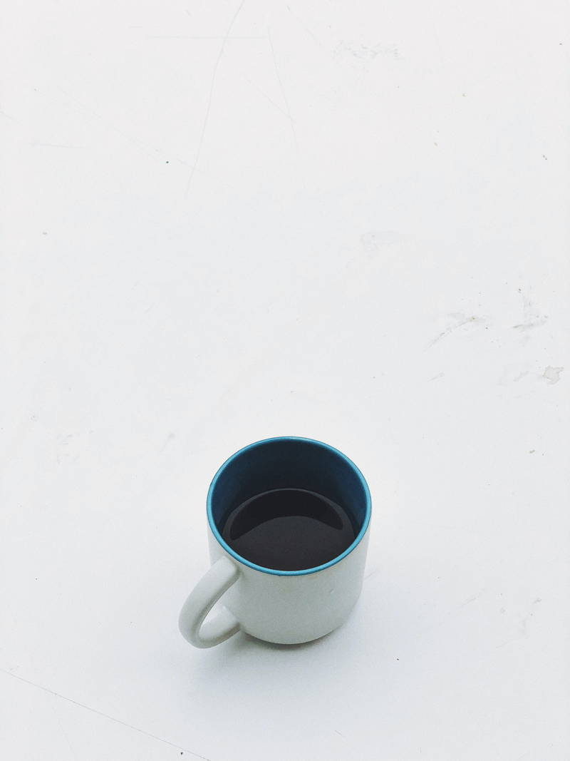 Half-filled coffee cup