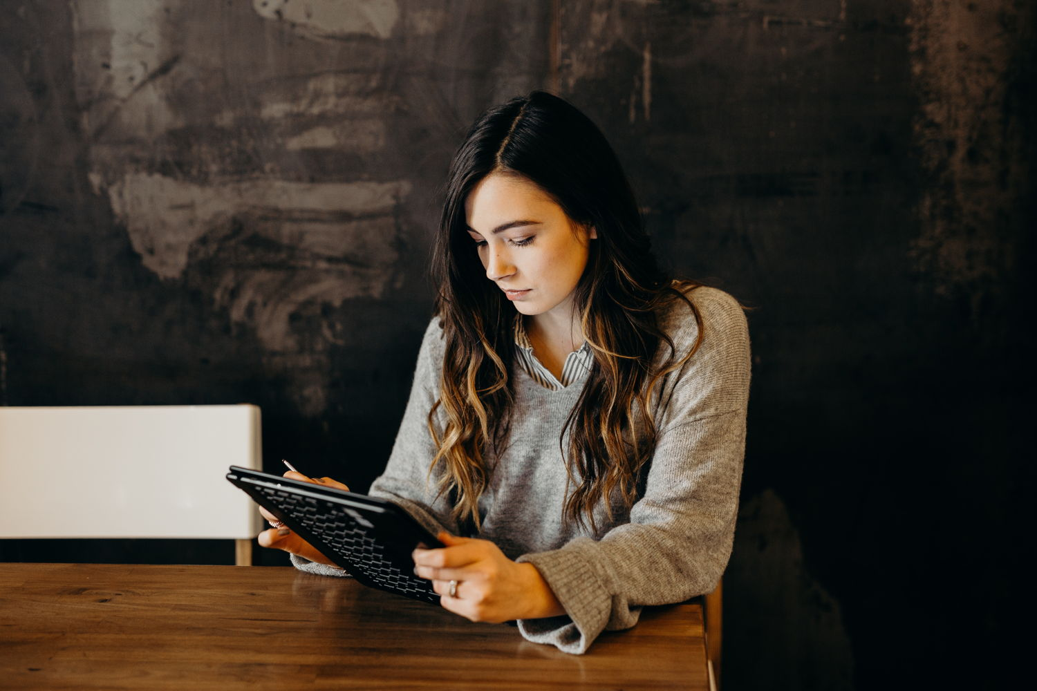 Young woman writing a cover letter