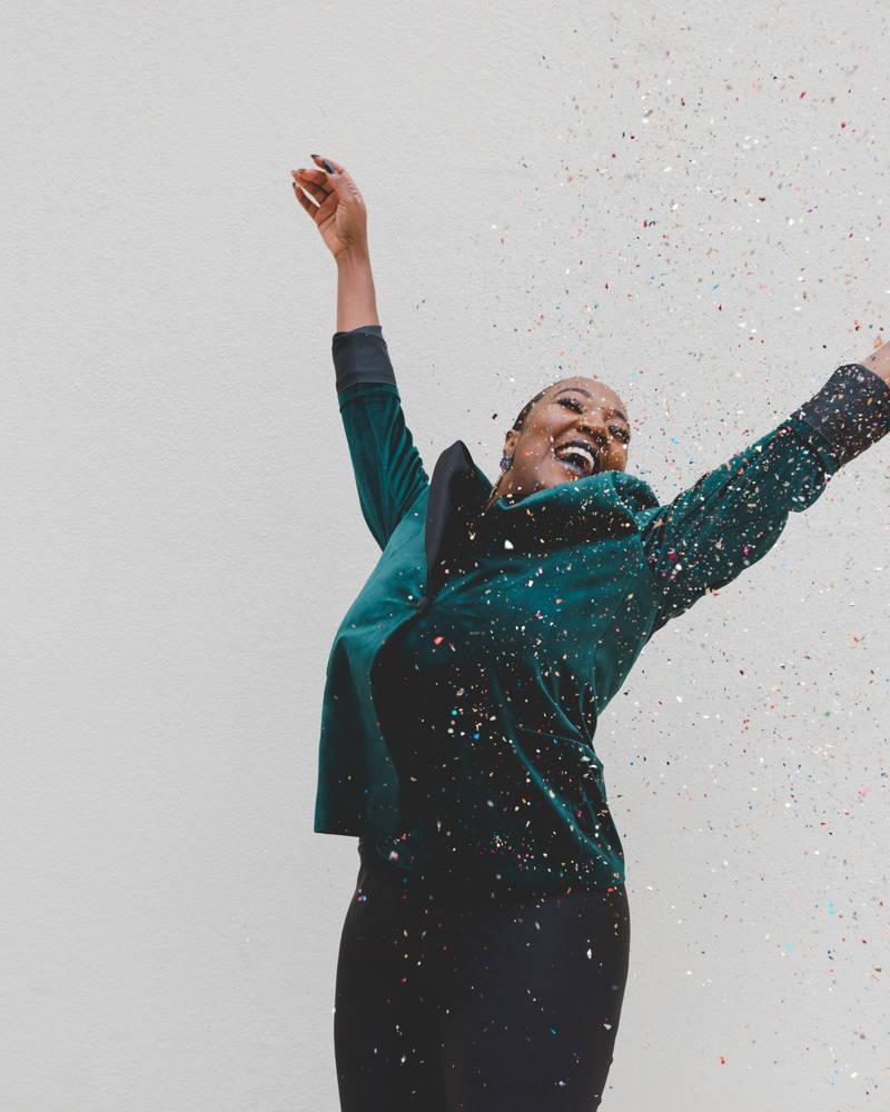 Confetti falling on a very happy woman