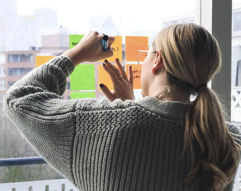 Woman brainstorming at work
