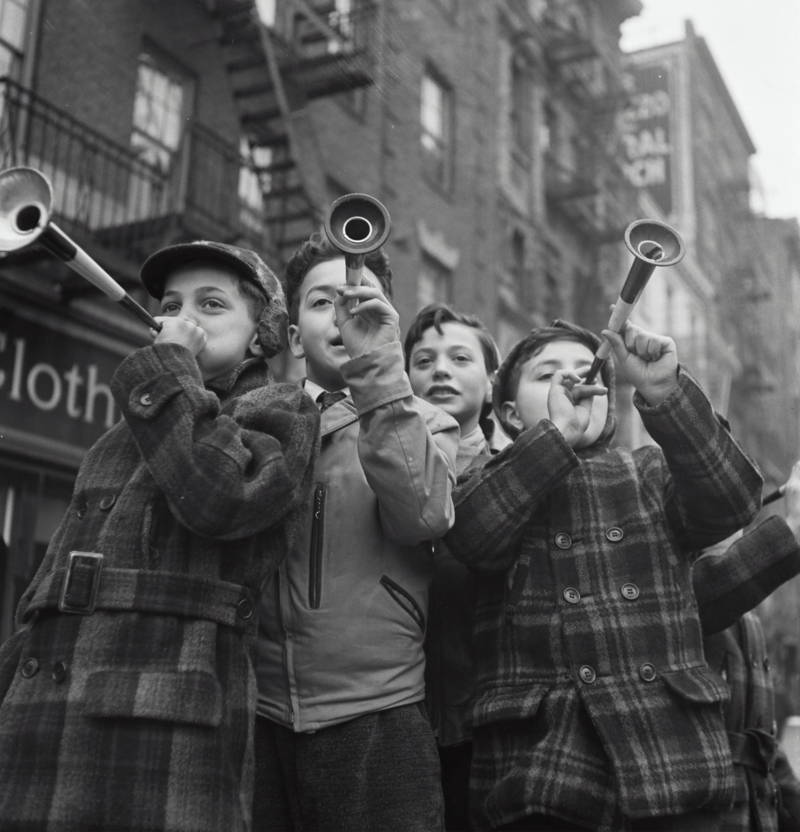 Vintage photo of boys blowing horns