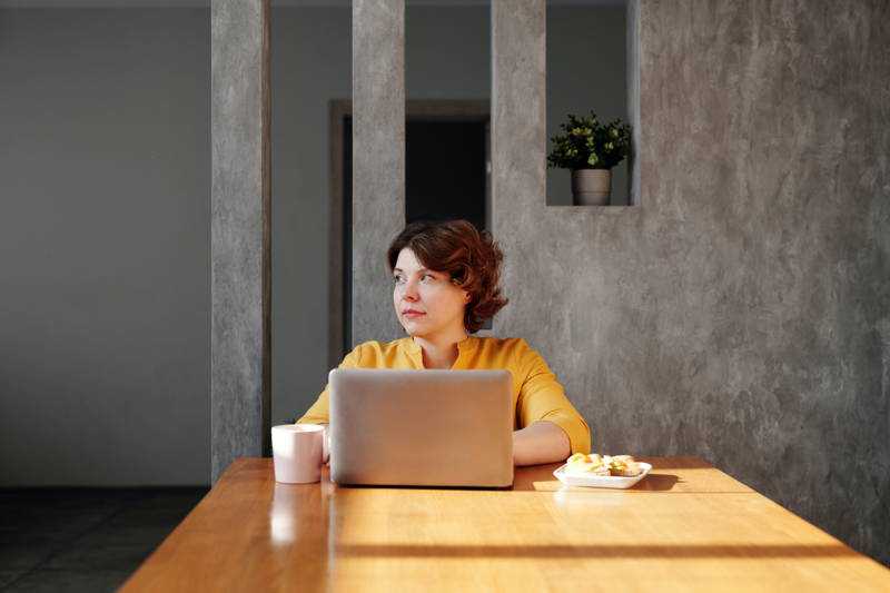 Woman stressed and sitting at her computer