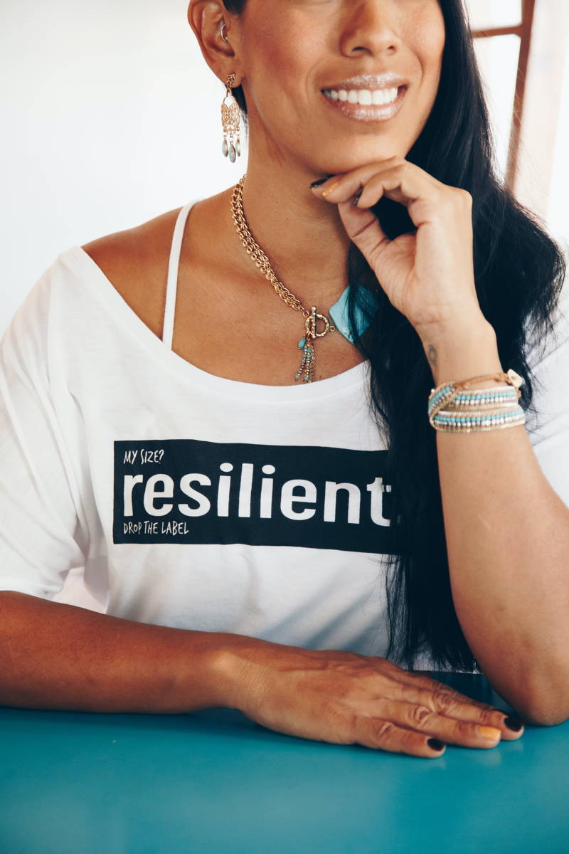 """Woman wearing a shirt that says """"resilient"""""""