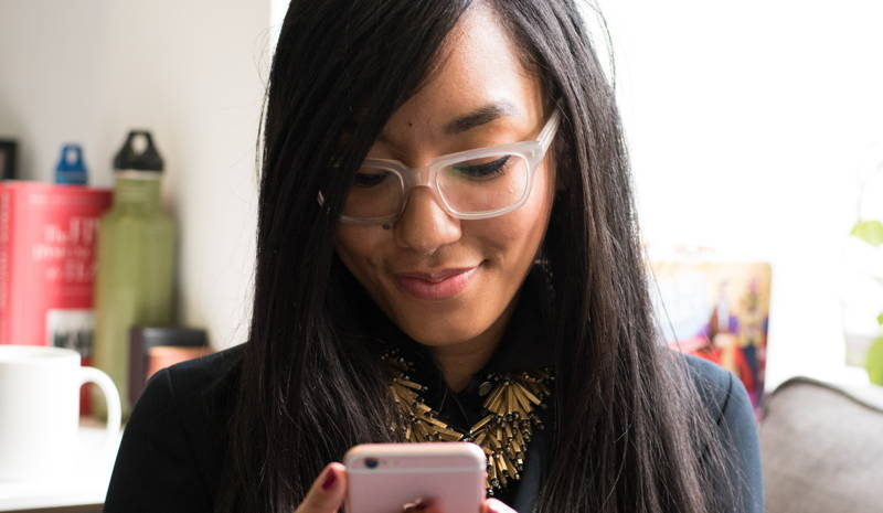 Woman procrastinating on her phone