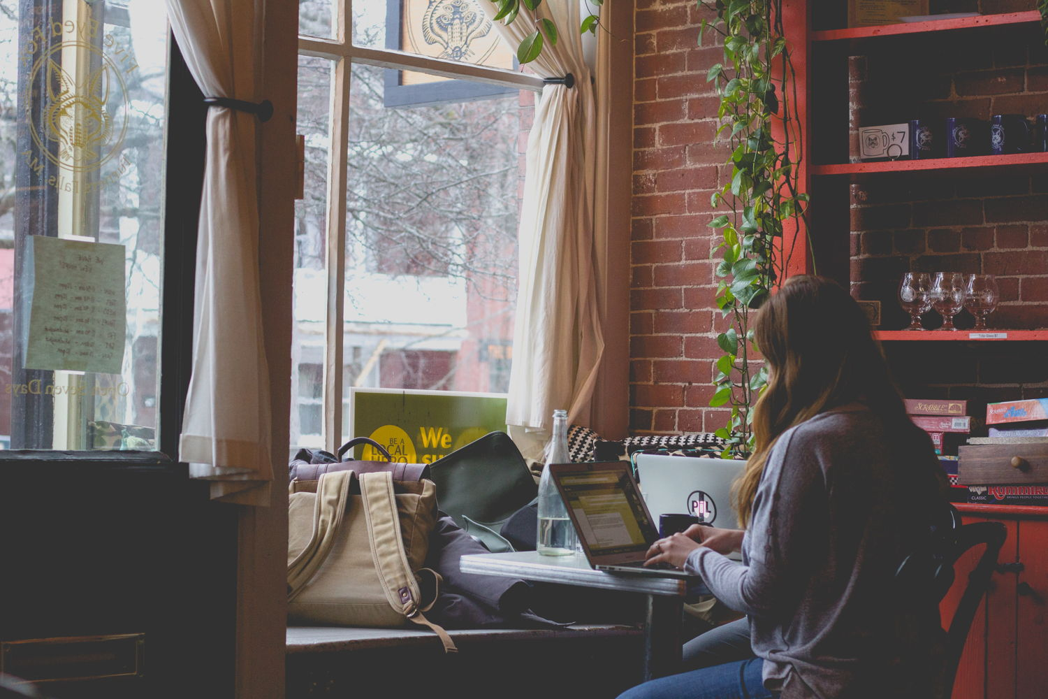 woman working on her computer at a coffee shop