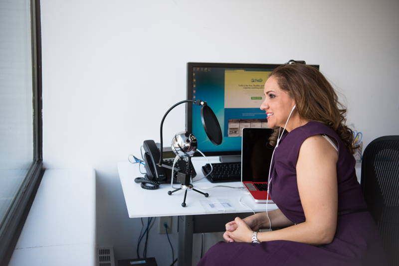 Woman recording a podcast in a modern office
