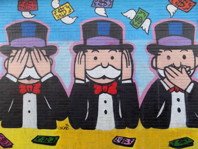 Monopoly man in see no evil, speak no evil, hear no evil pose