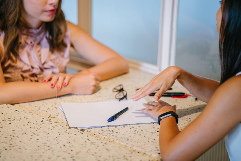Women editing resume