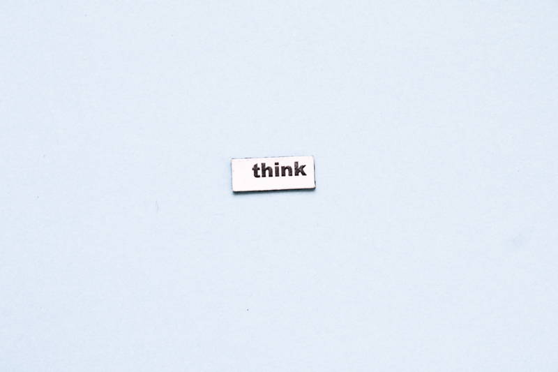 """Light blue box with the word """"think"""" in it"""