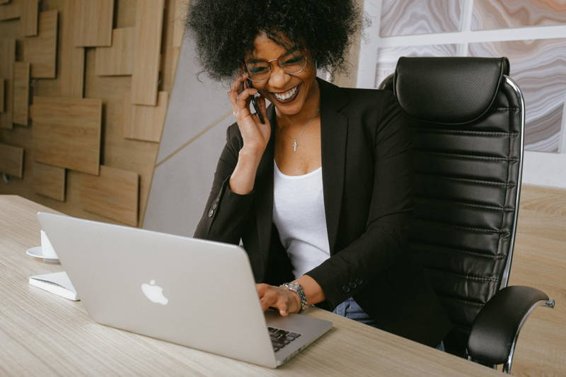 woman laughing while on the phone